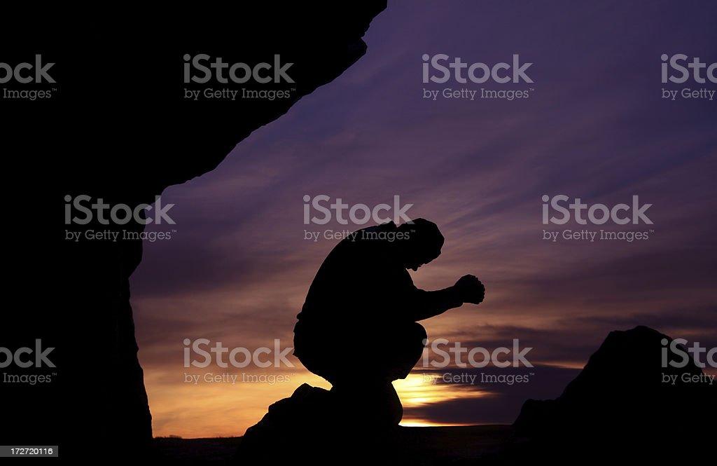 Man prays against beautiful sunset on Mountain royalty-free stock photo