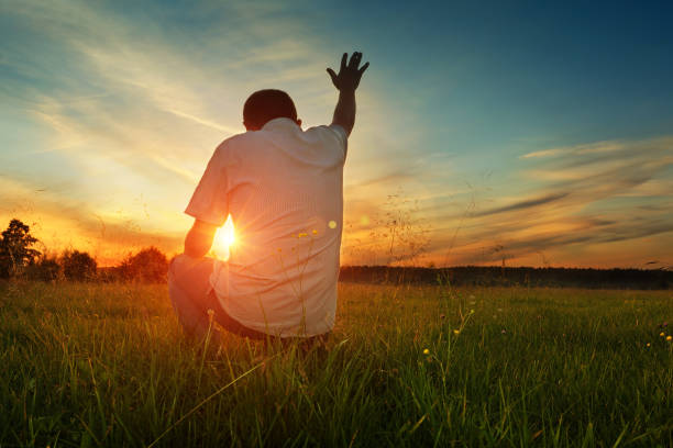 man prays to god - god stock photos and pictures
