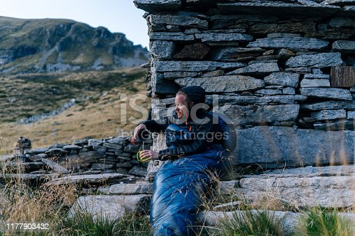 He is in a bivouac in the mountain alpine