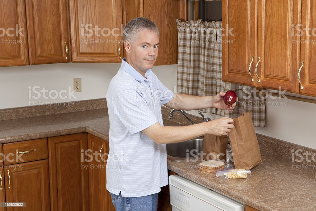 Man Preparing Bag Lunches royalty-free stock photo