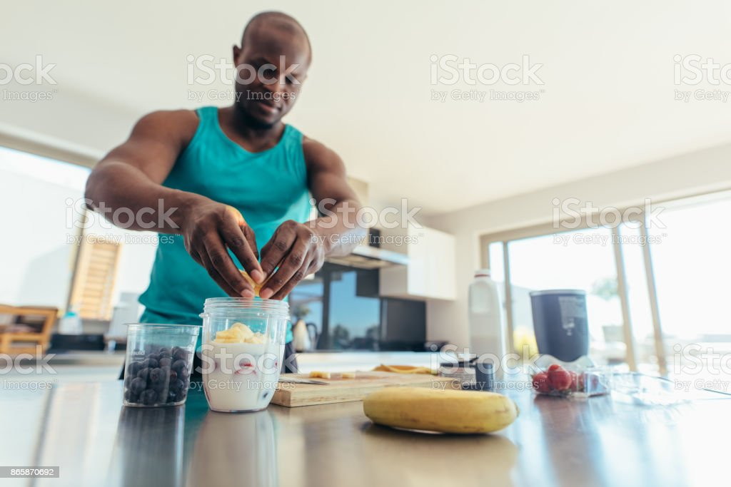 Man preparing breakfast in kitchen stock photo