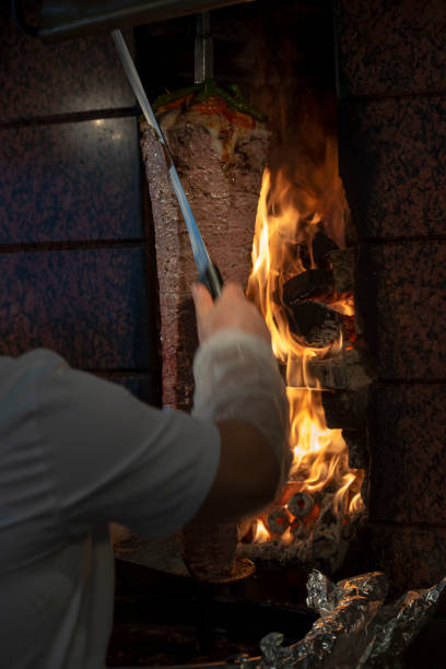 Man preparing Doner Kebab in Istanbul Doner Kebab in Istanbul spit roasted stock pictures, royalty-free photos & images