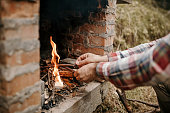 Man preparing outdoor barbecue fireplace