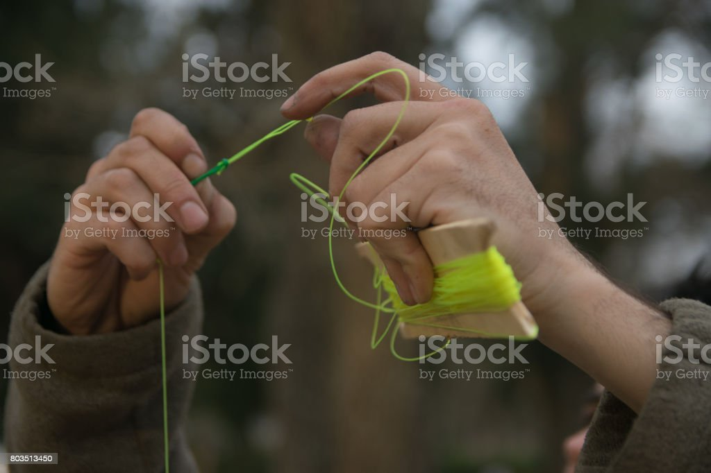 Man Preparing fishing line stock photo