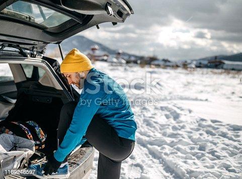 Man preparing for long run on snow