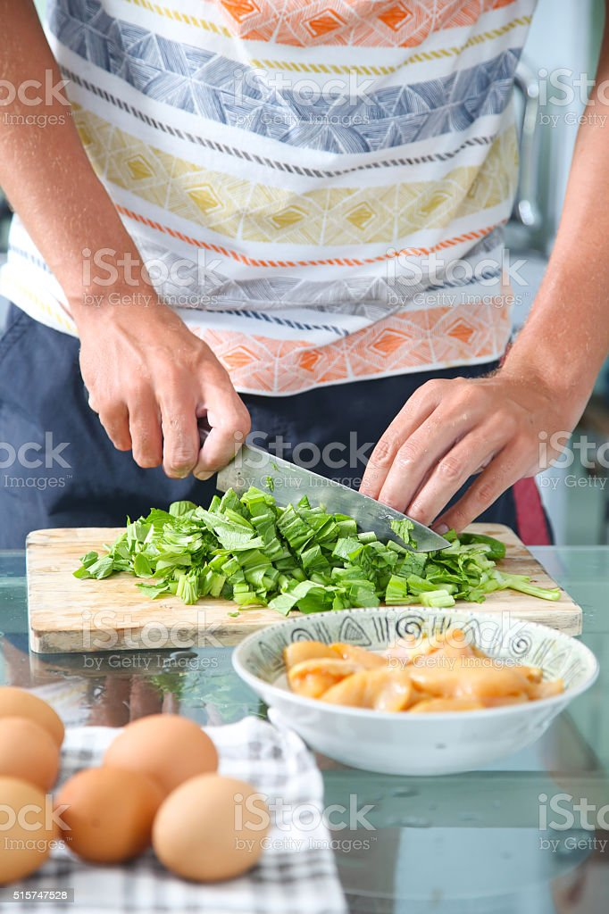 Man preparing ingredients for a healthy meal stock photo