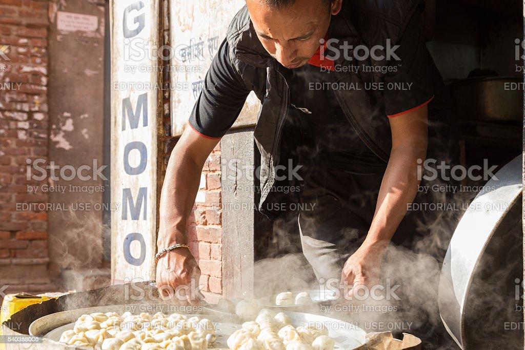 Man preparing steamed Momos, Nepal stock photo