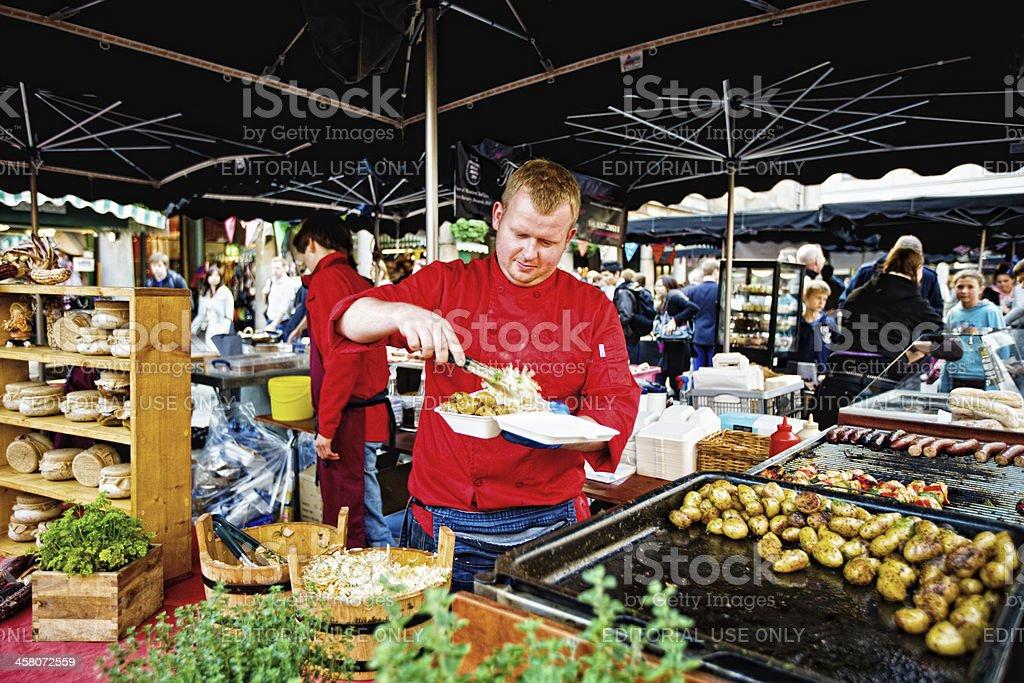 Man preparing take out food, Covent Garden Market, London royalty-free stock photo
