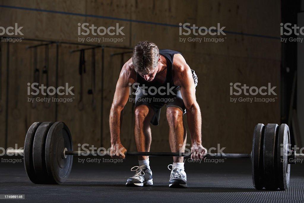 Man preparing to do deadlift royalty-free stock photo