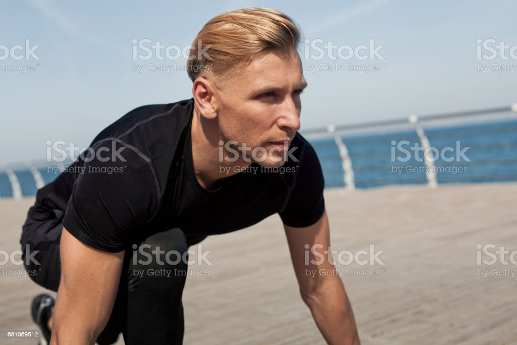 Man preparing to run royalty-free stock photo
