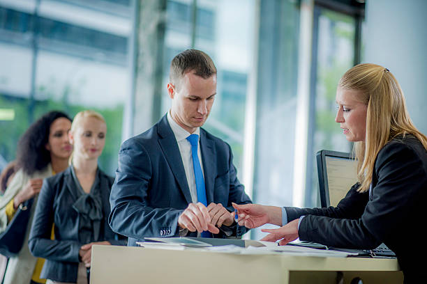 Man preparing to sign a bank contract stock photo