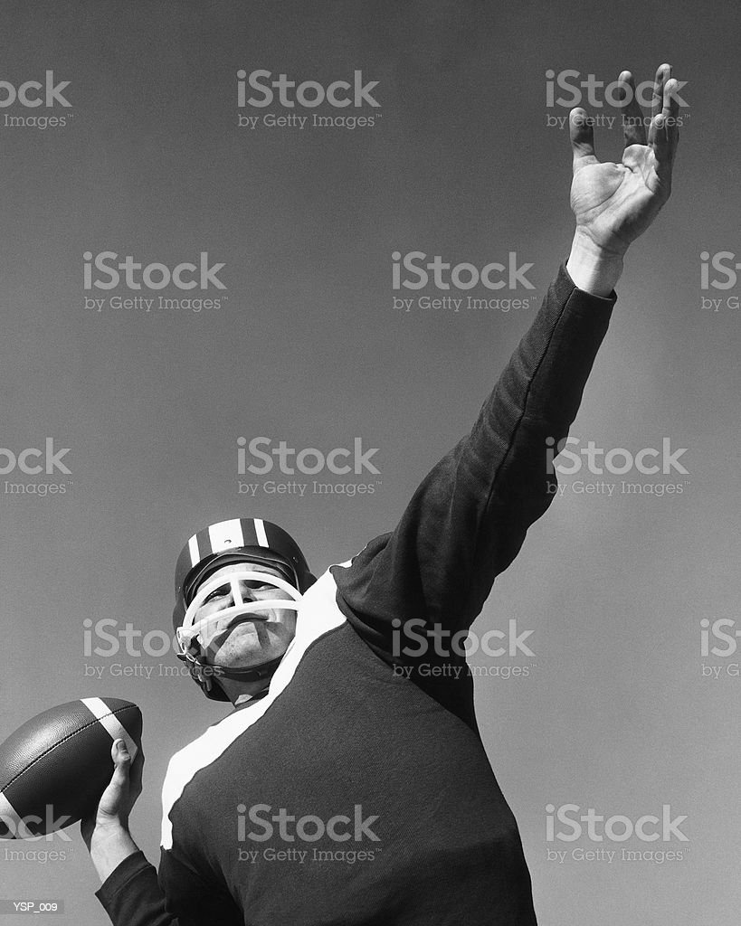 Man preparing to throw football royalty-free stock photo