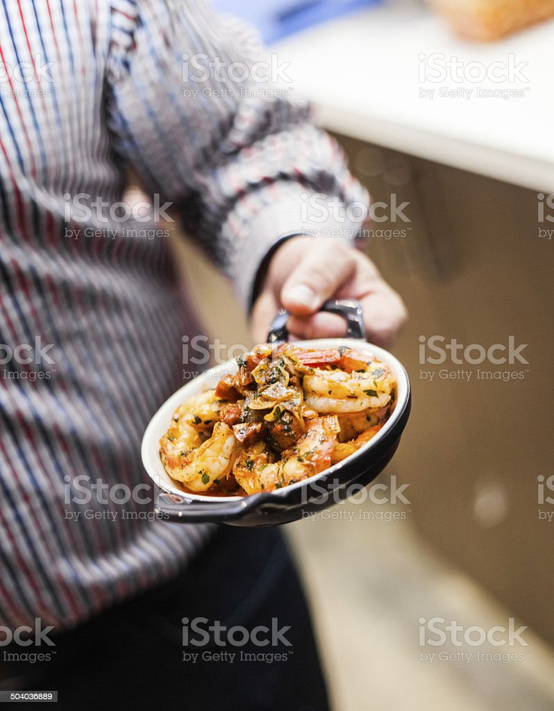 Man Presenting a Typical Tradional Portugese Meal stock photo