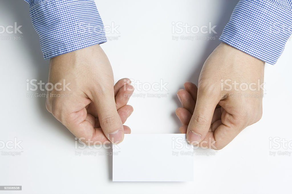 Man presenting business card stock photo