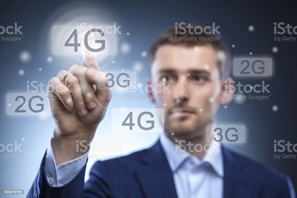 man pressing 4g touchscreen button stock photo