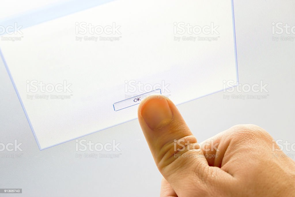 Man pressing button on touch screen monitor royalty-free stock photo