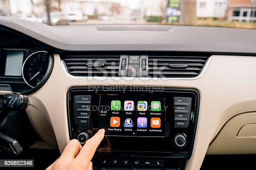 istock Man pressing home button on the Apple CarPlay 639852346