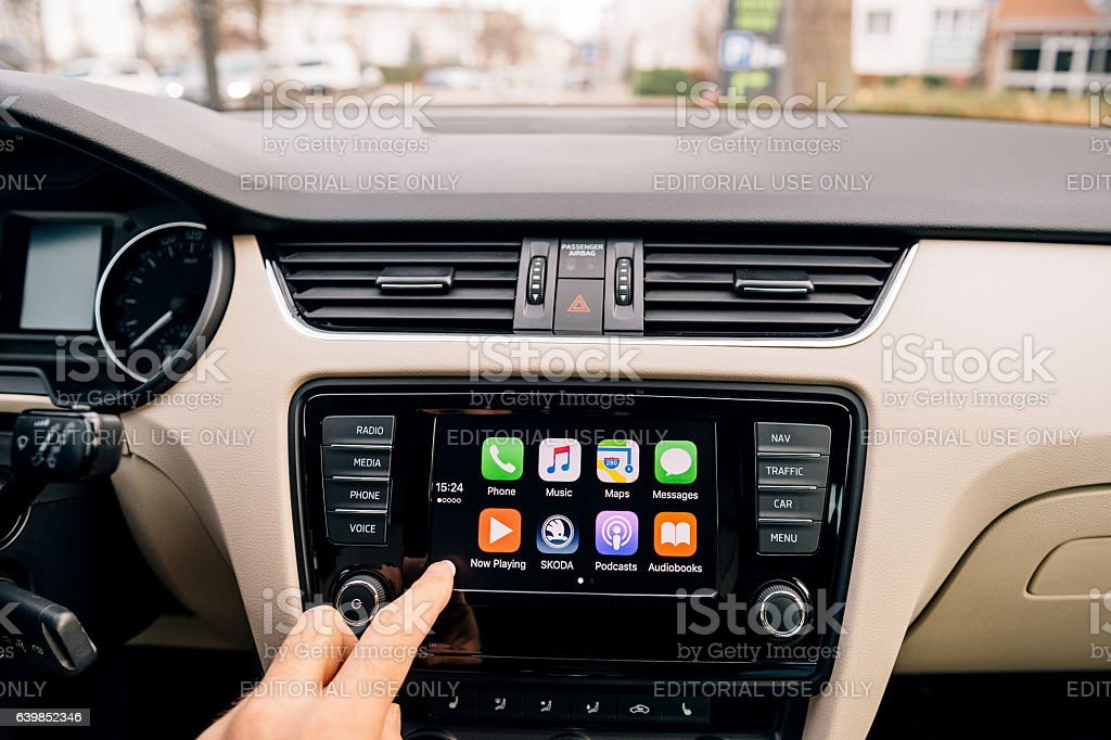 Man pressing home button on the Apple CarPlay stock photo