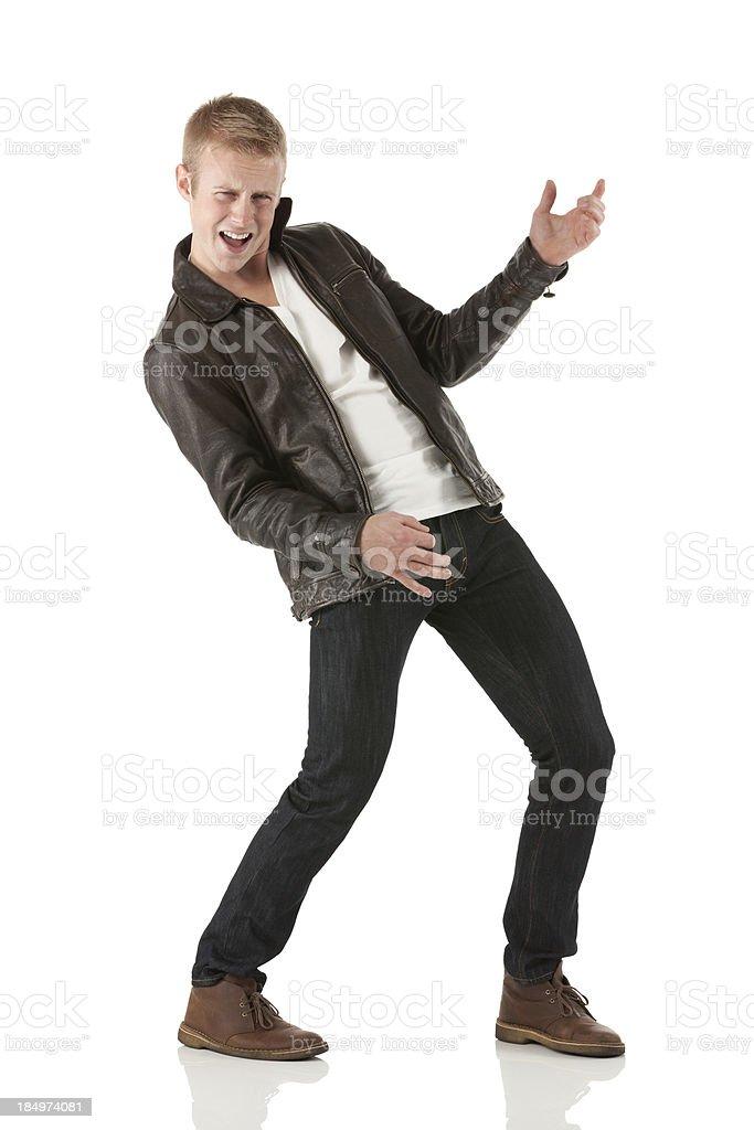 Man pretending to play guitar stock photo