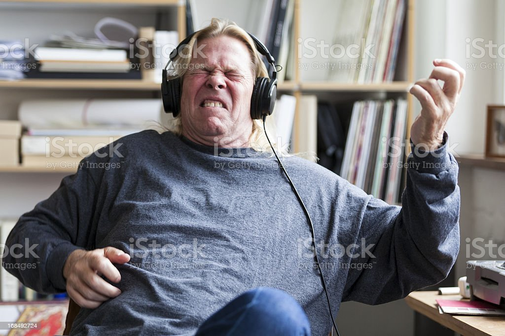 Man Pretends to Play Guitar Listening to Music stock photo