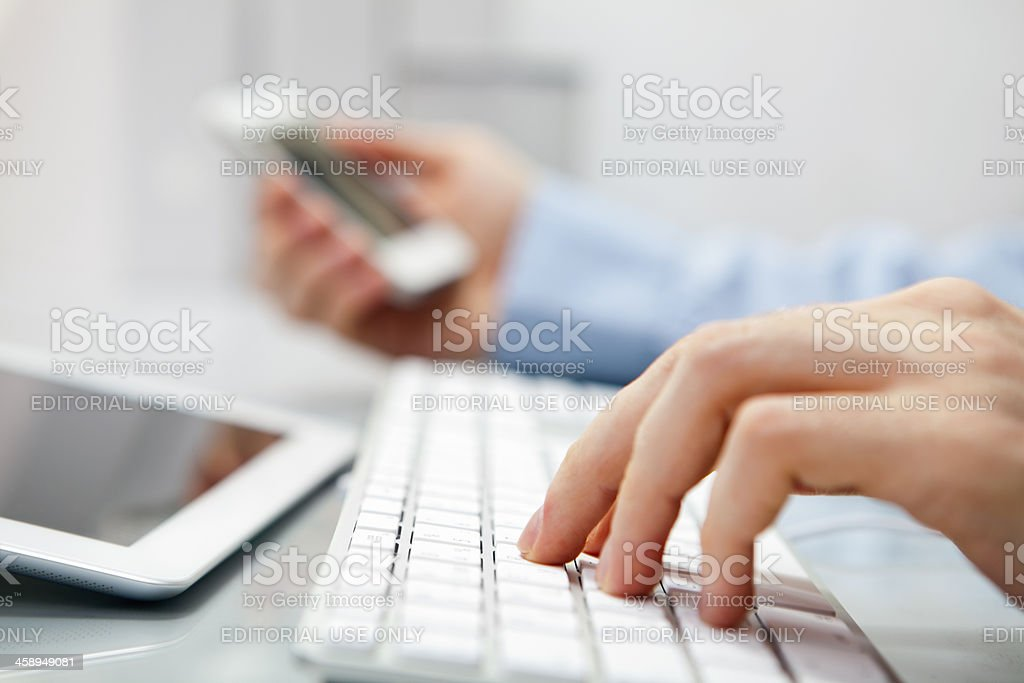 Man printing on keyboard royalty-free stock photo