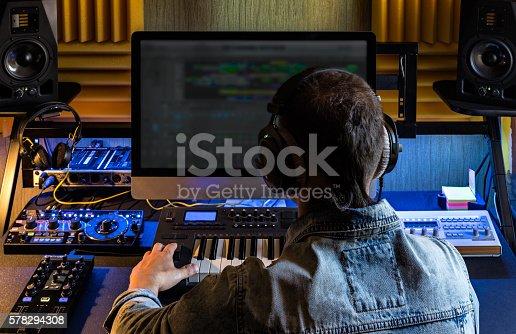 istock Man produce electronic music in studio 578294308