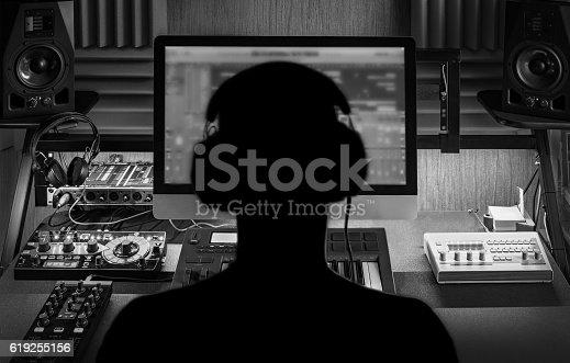 istock Man produce electronic music in studio 619255156
