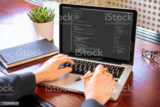 Man programming on a computer office background picture id1222626273?b=1&k=6&m=1222626273&s=612x612&h=n5jyy8tyw nvicsfvalx7d2agdo7p8vnkfjtyhudfdw=