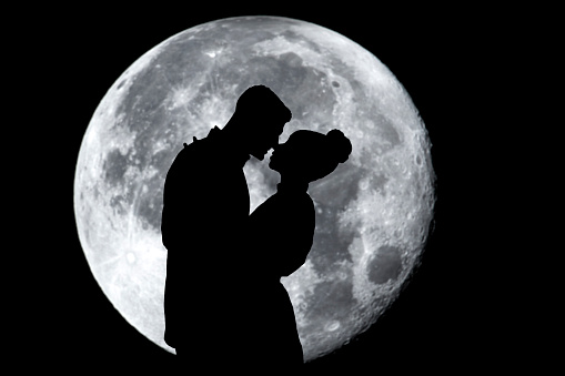 A man proposing by moonlight