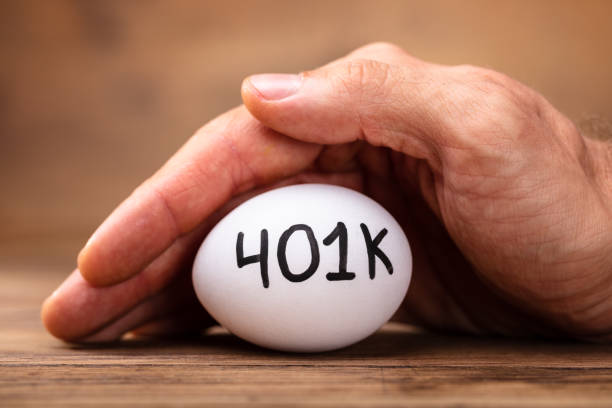 Man Protecting 401k White Egg Close-up Of A Man's Hand Protecting 401k White Egg 401k stock pictures, royalty-free photos & images