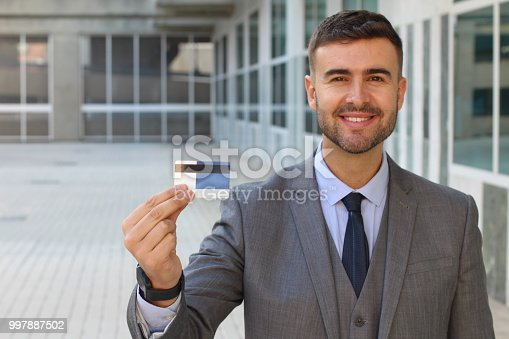 844190384 istock photo Man proudly showing a card 997887502