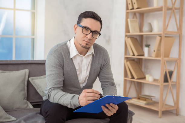 Man psychologist specialist professional doctor in the office stock photo