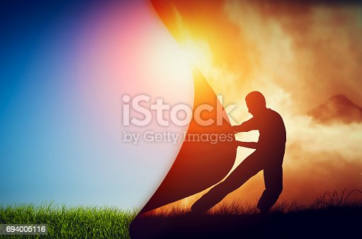 istock Man pulling curtain of darkness to reveal a new better world. Change. 694005116