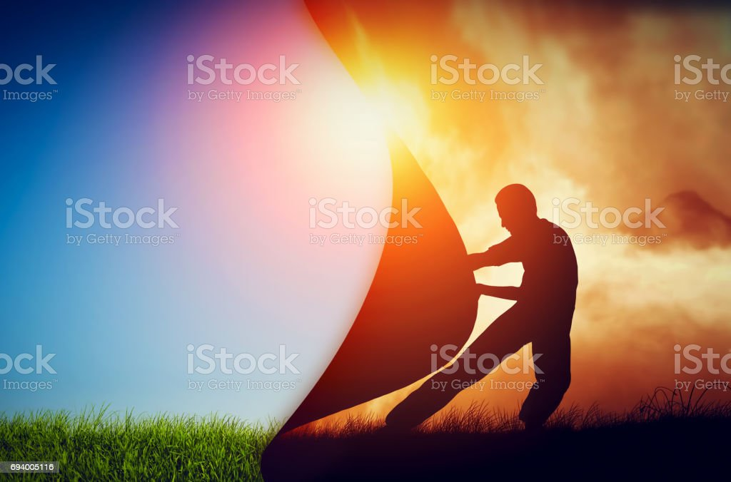 Man pulling curtain of darkness to reveal a new better world. Change. stock photo