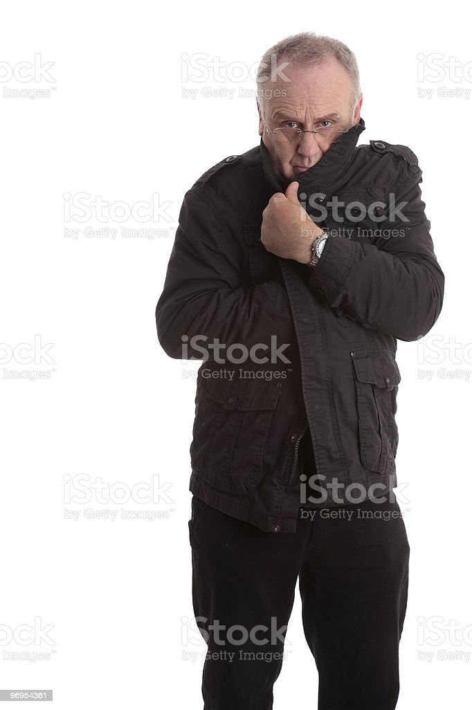 Man pulling his coat tight for warmth royalty-free stock photo