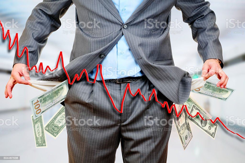 Man Pulling out Empty Pocket stock photo