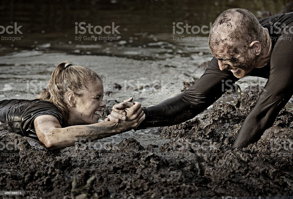 man pulling out of water laughing woman stock photo