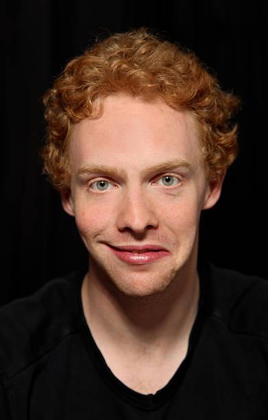 Man pulling unusual face stock photo