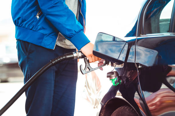 Man pumping fuel in car at gas station Male hand holding fuel pump nozzle, Diesel Fuel, Car, biodiesel stock pictures, royalty-free photos & images