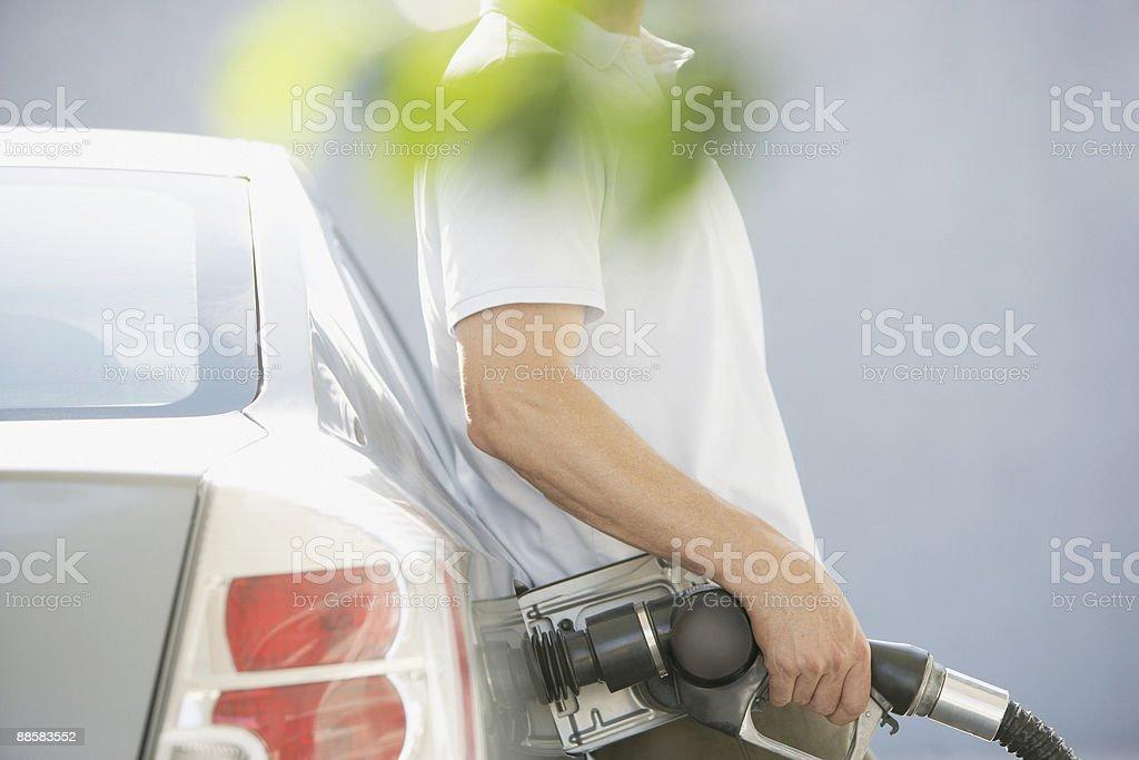 Man pumping gas royalty-free stock photo