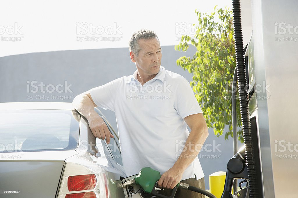 Man pumping gas stock photo