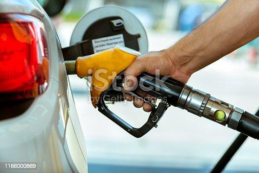 Man pumping gasoline oil