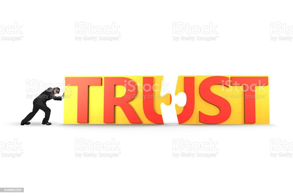 Mann-Push-Puzzle-Teile mit Wort Vertrauen zusammen – Foto