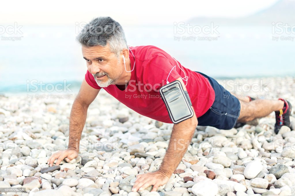 Man Push Up Workout Outside By The Sea Stock Photo
