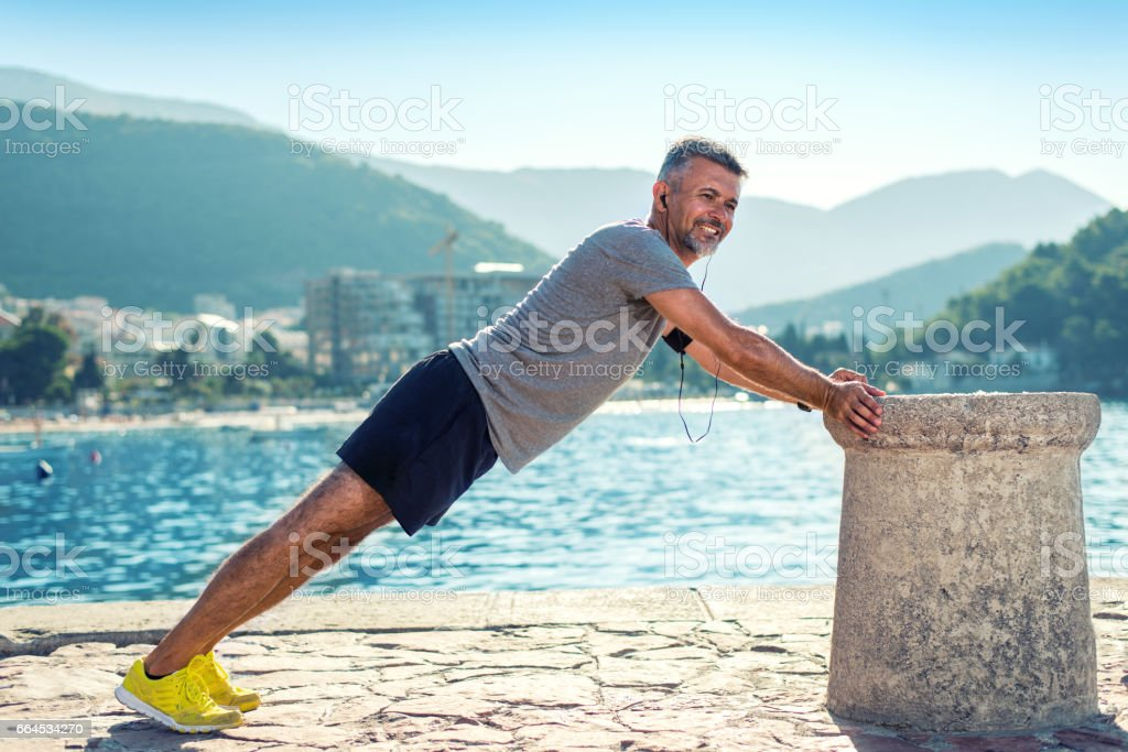 Man push up workout outside by the sea royalty-free stock photo