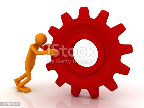 istock Man pushing a big gear 967529788