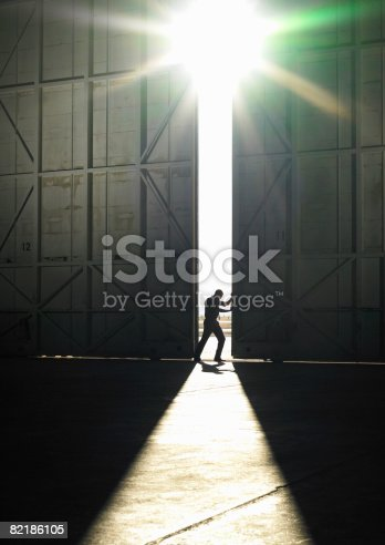 istock man pushing door open 82186105