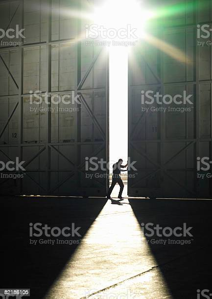 Man Pushing Door Open Stock Photo - Download Image Now