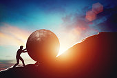 Man pushing huge concrete ball up hill. Sisyphus metaphor. Sisyphean work, big challenge concept. 3D illustration