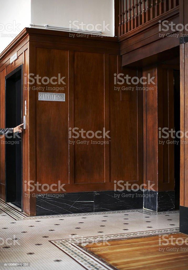 Man pushing lift button royalty-free stock photo